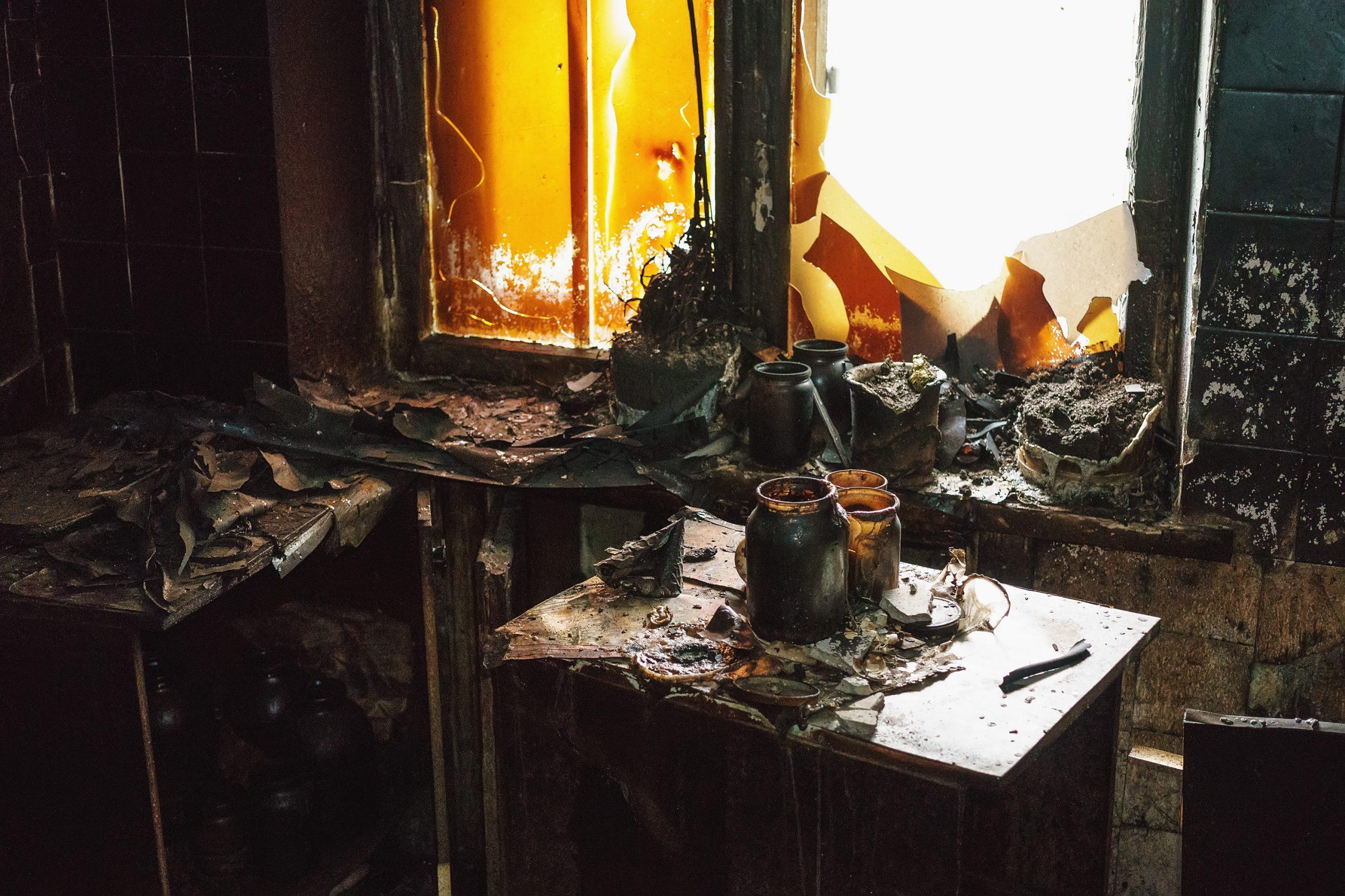 Interior inside the burnt room, furniture, utensils